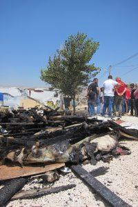 The immediate aftermath of a tent fire in an informal refugee settlement in Zahle, Beqaa Valley, Lebanon