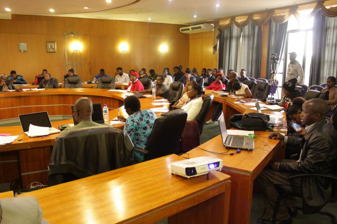 Participants at the community lecture follow proceedings at NUST