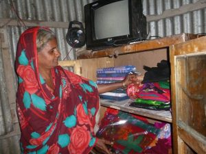 Ramaaza at home with her stock cupboard
